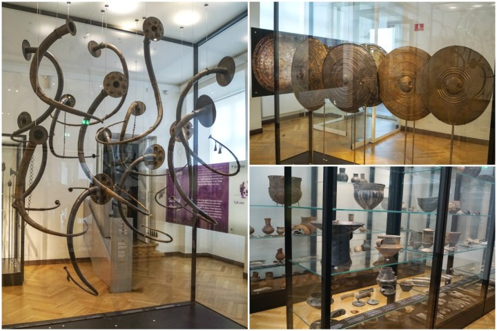 Exhibits-instruments, shields, and pottery inside Nationalmuseet