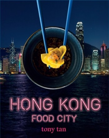 Hong Kong Food City cookbook cover- Background of Hong Kong with a pair of chopsticks holding a dumpling over a bowl and words Hong Kong Food City, Tony Tan in pink letters.