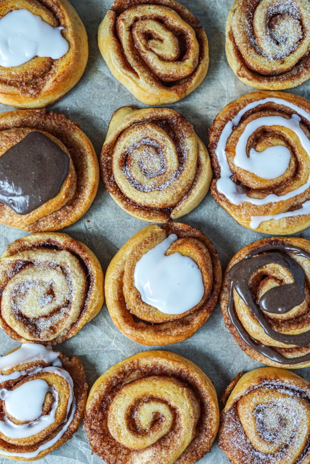 Kanelsnegle (Danish Cinnamon Rolls) topped with a variety of sugar and glazes