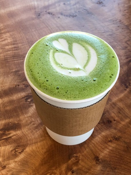 Matcha Latte in a paper cup from Reverent Coffee Bar.