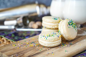 Four Brandy Milk Punch Macarons on a wooden board.