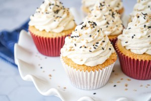 Six Salted Tahini Cupcakes on a white platter.