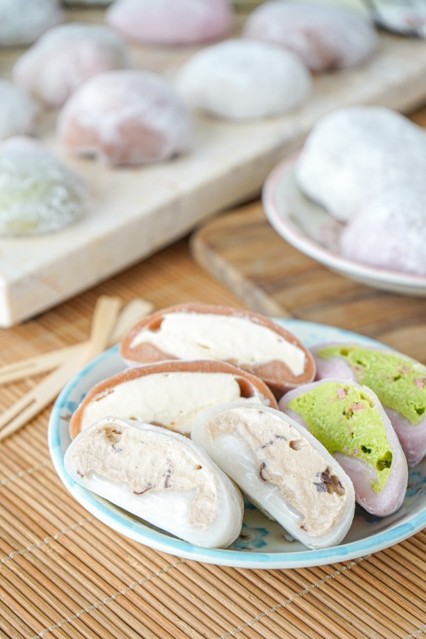 Six halves of Mochi on a blue flower plate with more in the background.