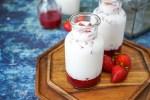 Korean Strawberry Milk in two glass jars.