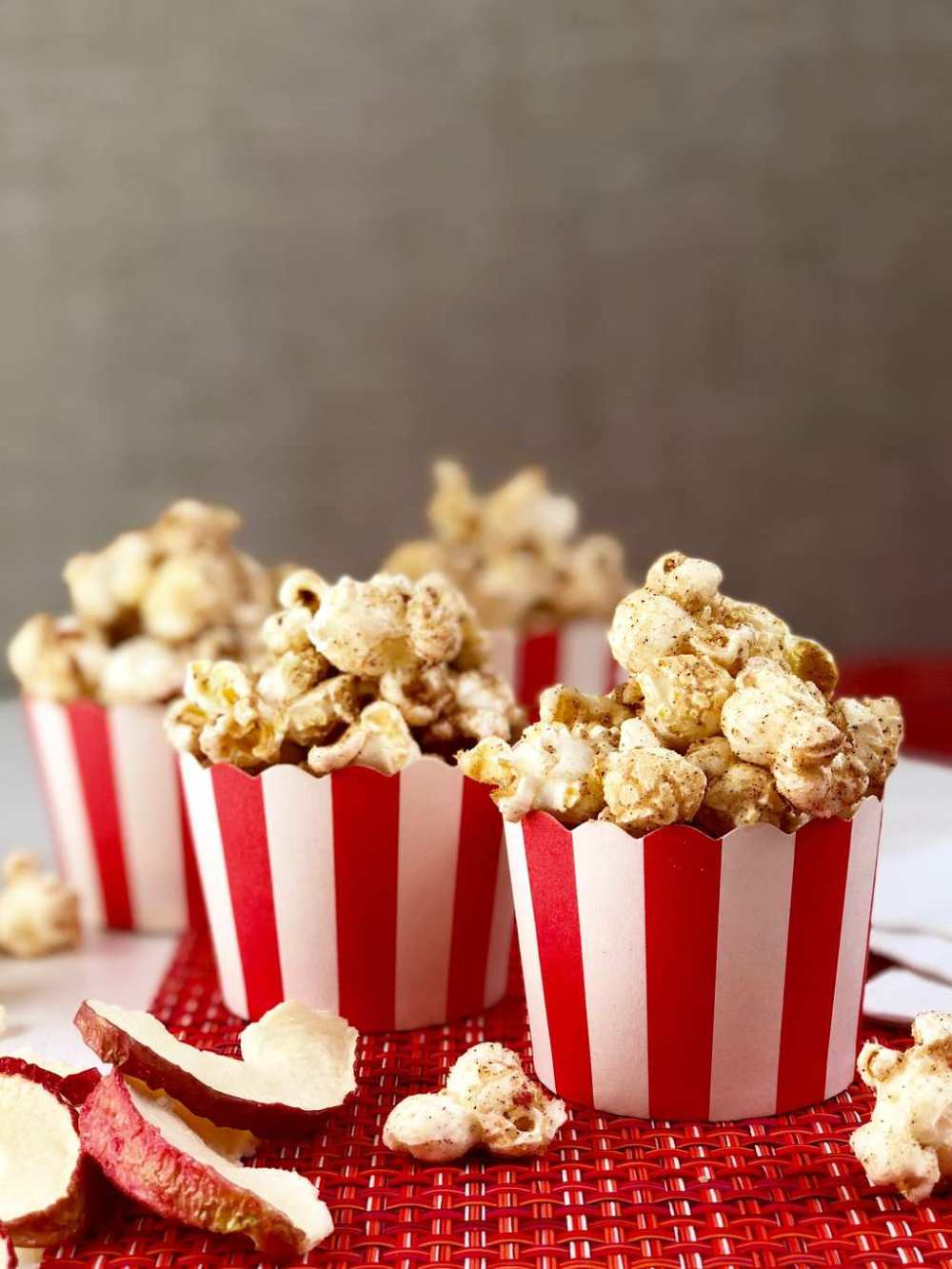 Apple cinnamon popcorn in red and white cups