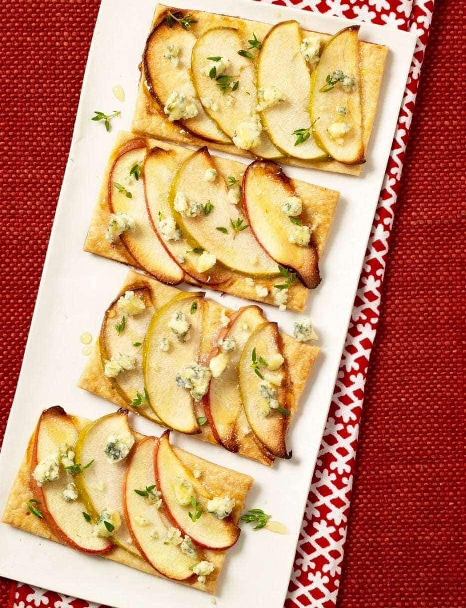 Easy Apple Tarts get a sprinkling of blue cheese for an unexpected, yet perfectly paired addition to a seasonal snack.