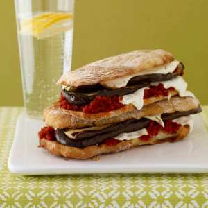 Eggplant and mozzarella panini on plate with water