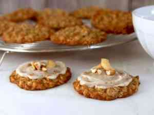 Cashew Oatmeal cookies with brown butter frosting on cooling rack