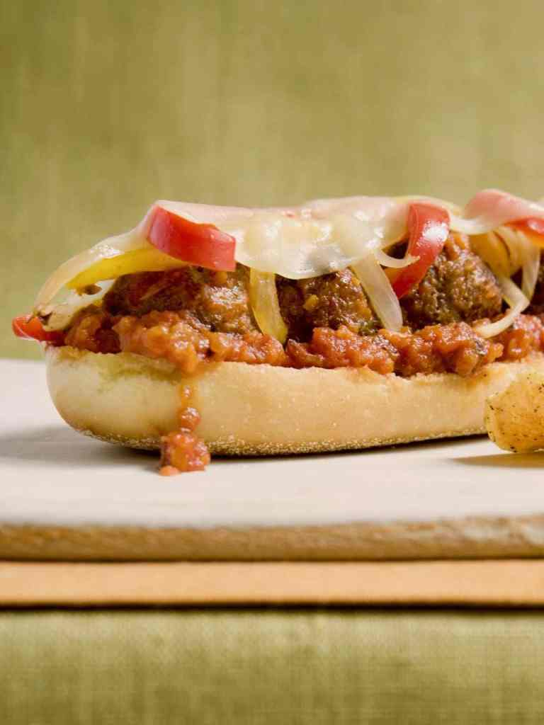 A delicious open face meatball sub on a cutting board