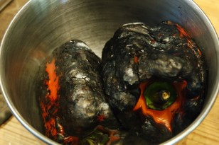 Put the roasted peppers in a heatproof bowl and cover with cling film or a plate.