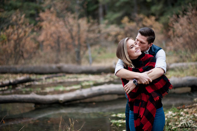 Couple embrace during their Big Hill Springs engagement session captured by Tara Whittaker Photography