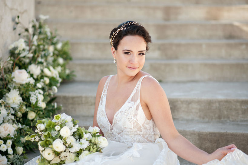 Bride on the Grand Staircase one of Calgary's most regal wedding ceremony sites captured by Tara Whittaker Photography