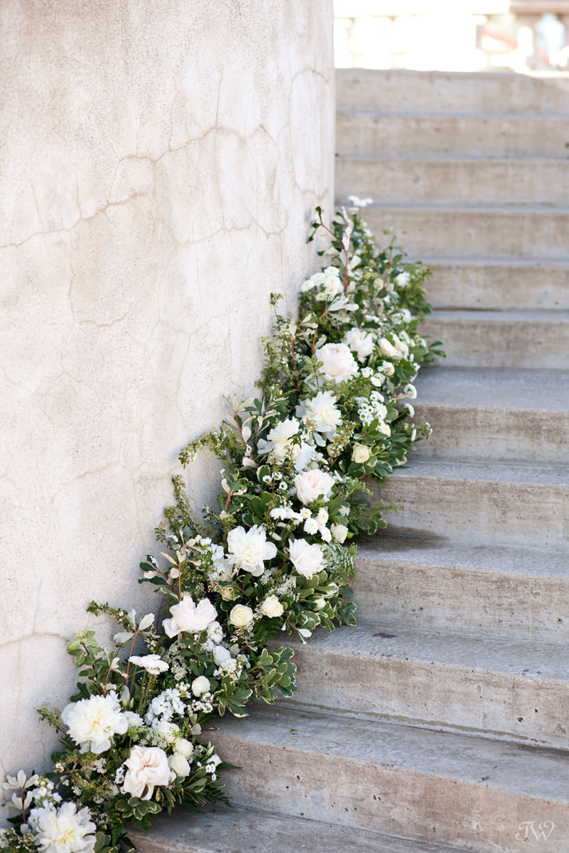 Floral treatment from Flowers by Janie on the Grand Staircase at Spruce Meadows captured by Tara Whittaker Photography