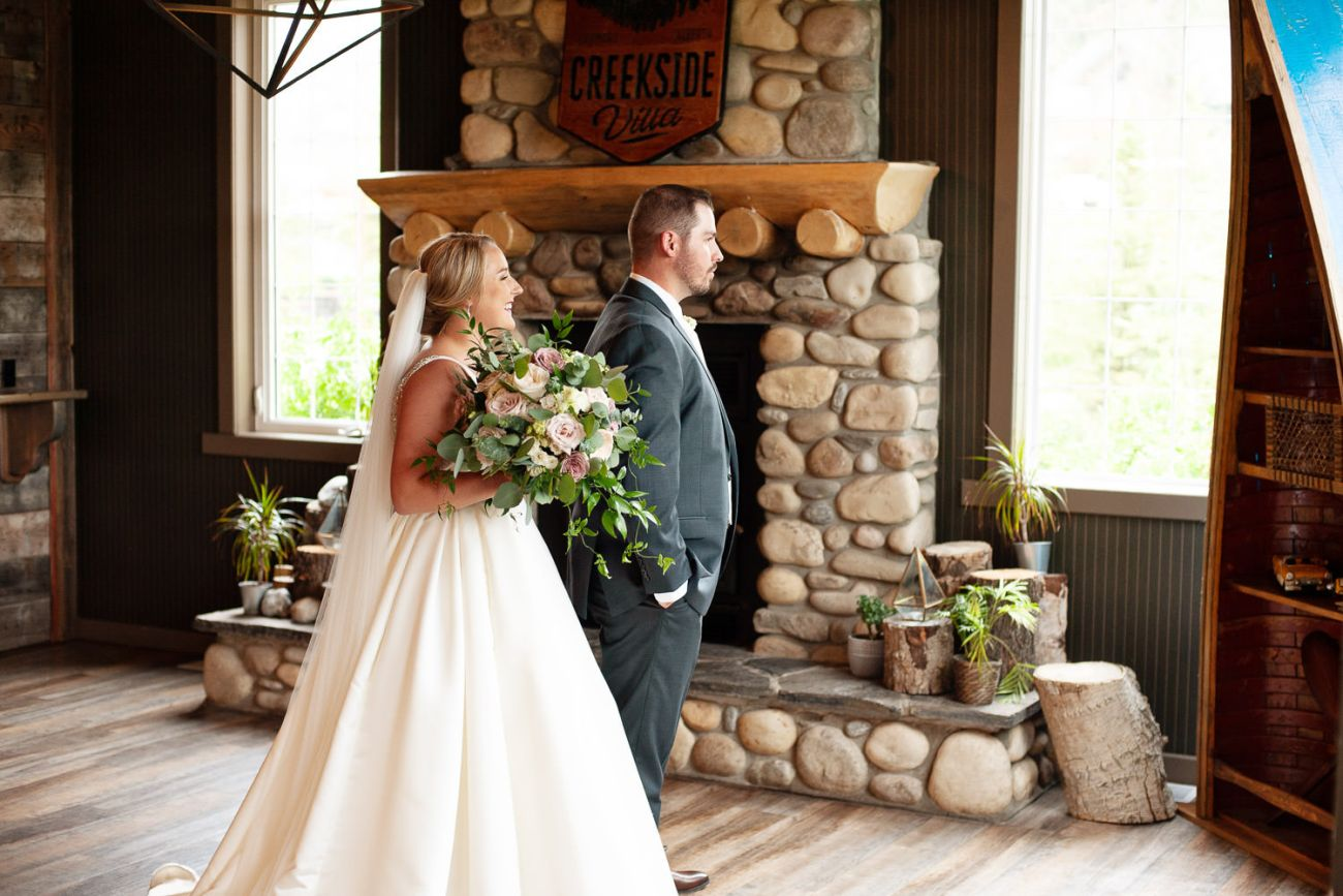 First look before a Creekside Villa wedding captured by Tara Whittaker Photography