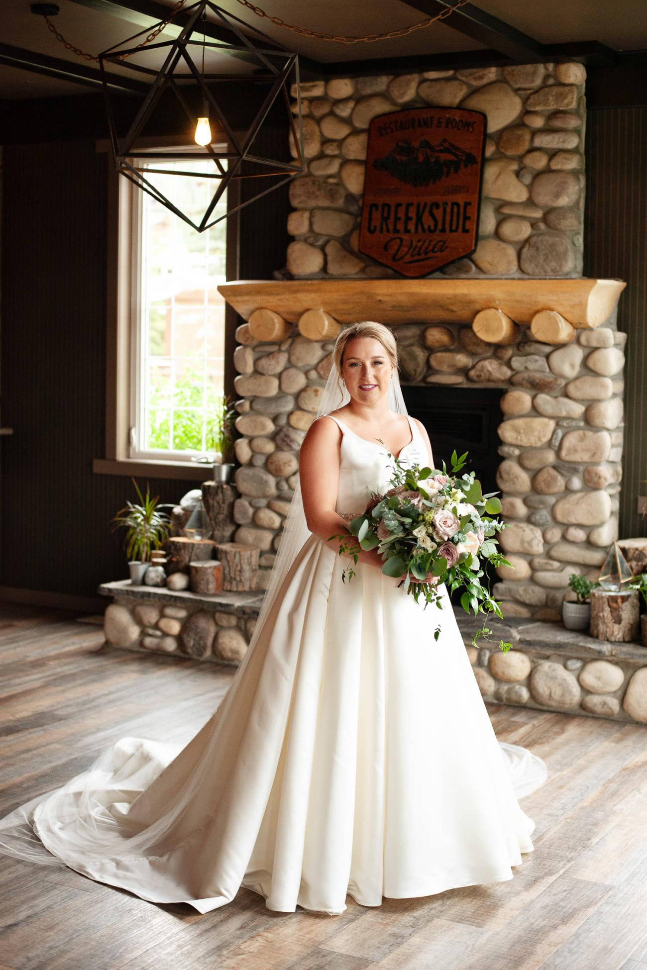 Bride poses at Creekside Villa in Canmore captured by Tara Whittaker Photography