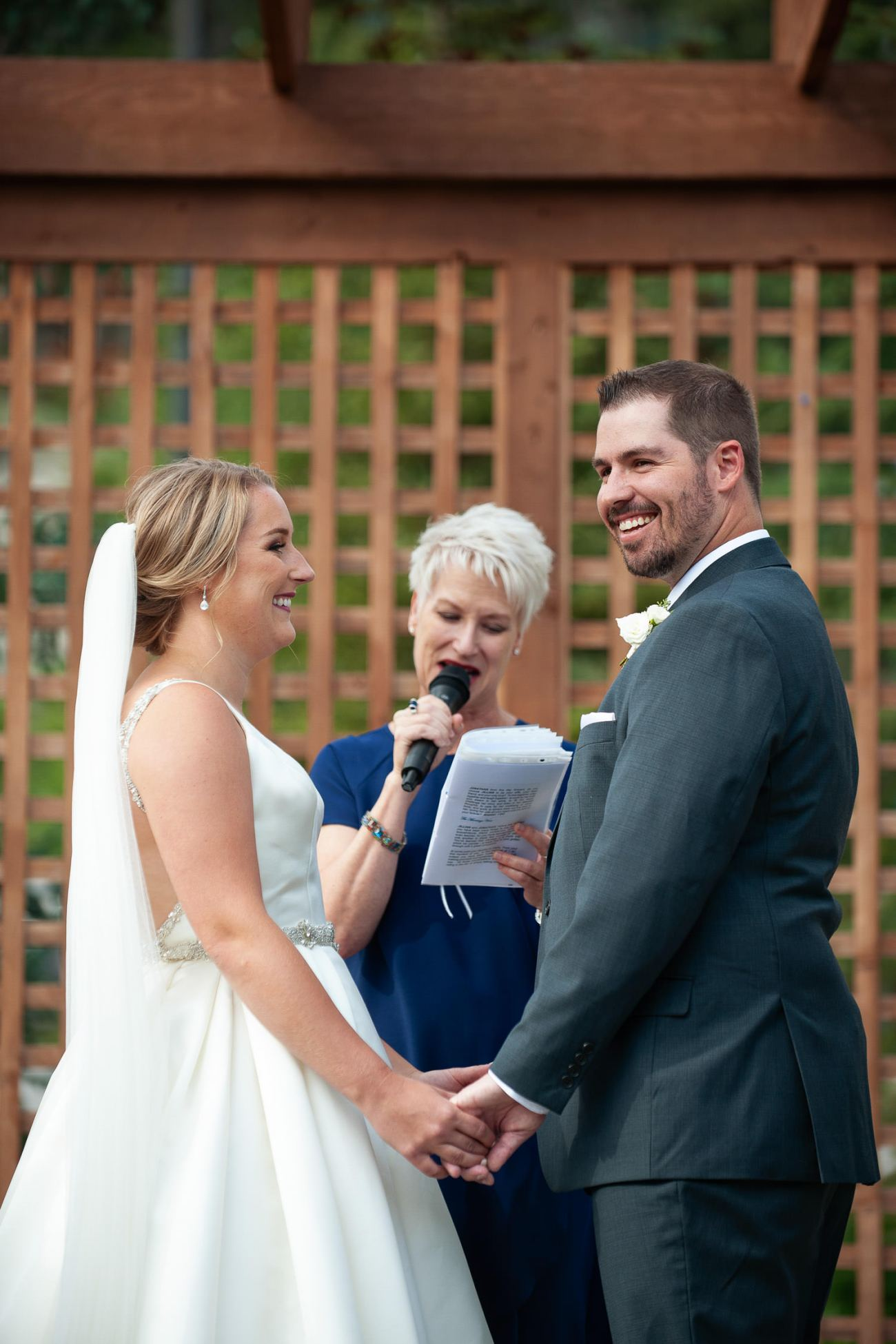 Wedding ceremony at Creekside Villa in Canmore captured by Tara Whittaker Photography
