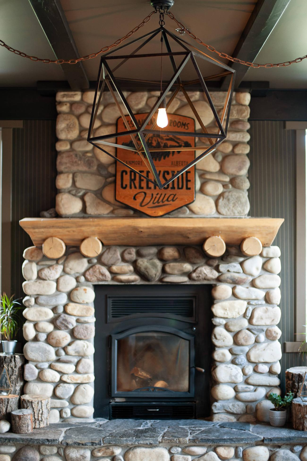 Rustic fireplace at Creekside Villa captured by Tara Whittaker Photography