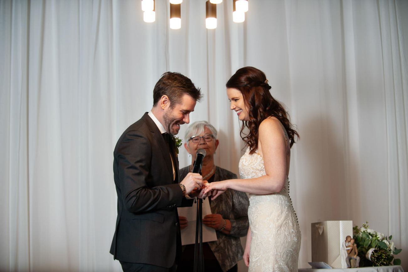 Wedding ceremony at Alforno in Eau Claire captured by Tara Whittaker Photography