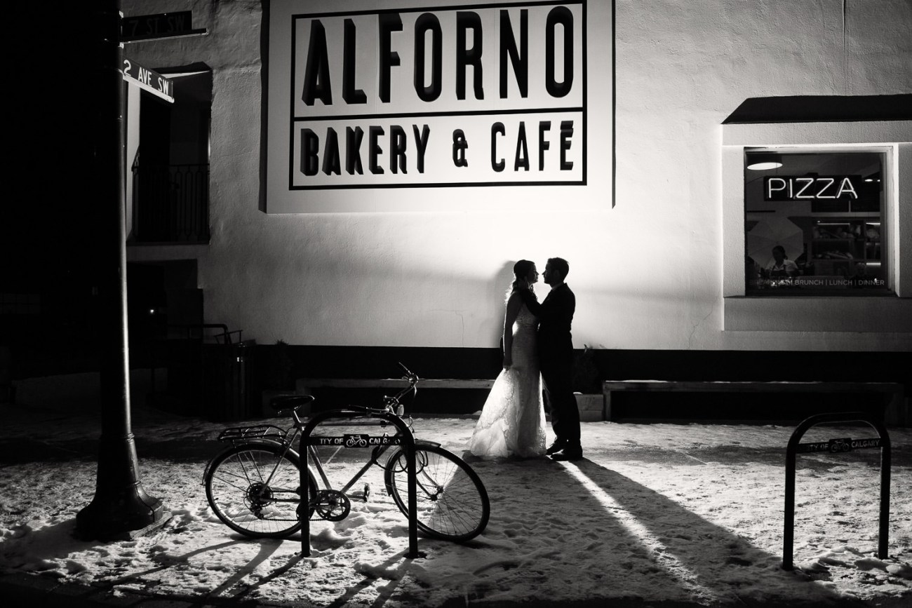 night shot of bride and groom outside of Alforno in Eau Claire captured by Tara Whittaker Photography