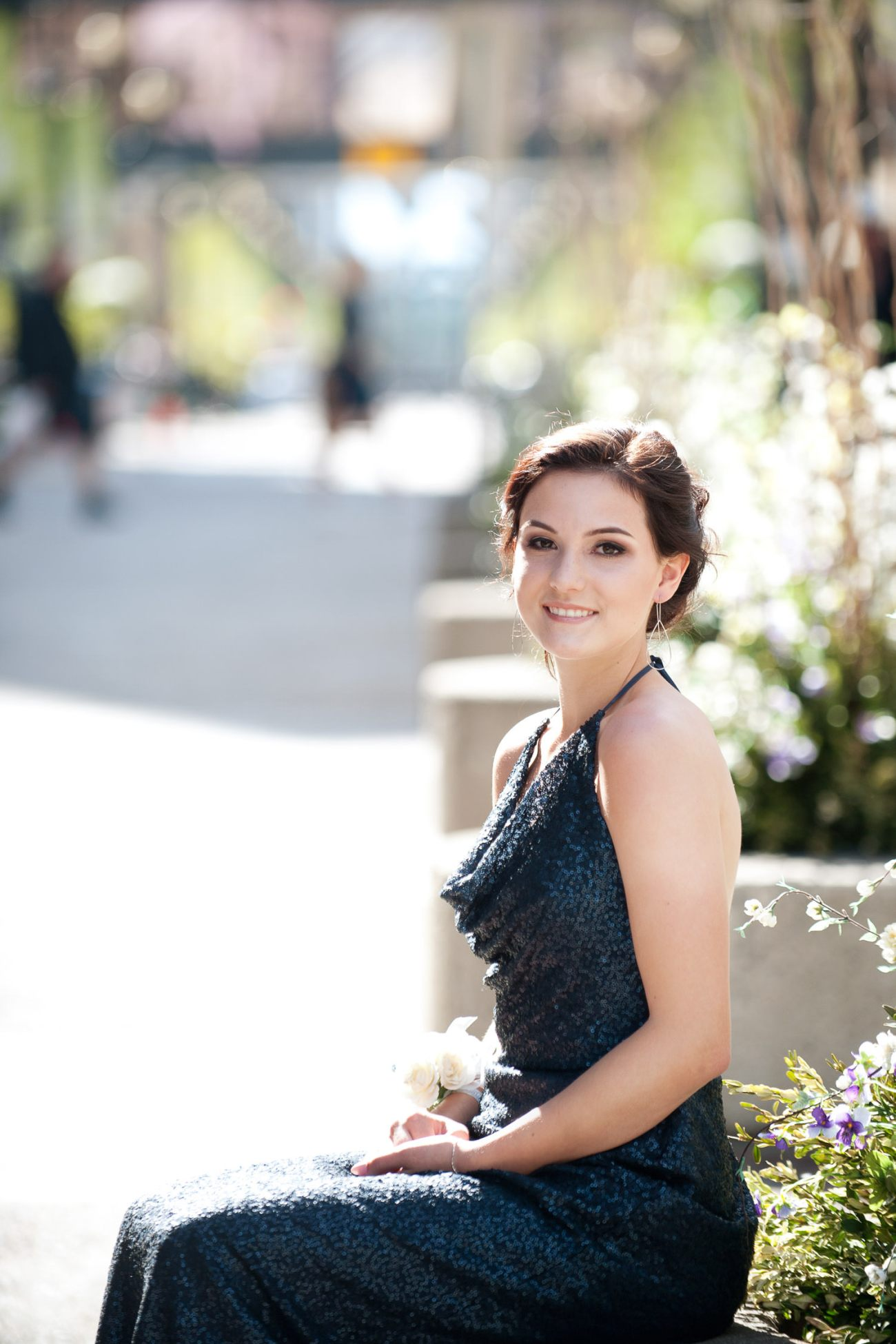 Graduate in her grad dress on Stephen Avenue captured by Tara Whittaker Photography