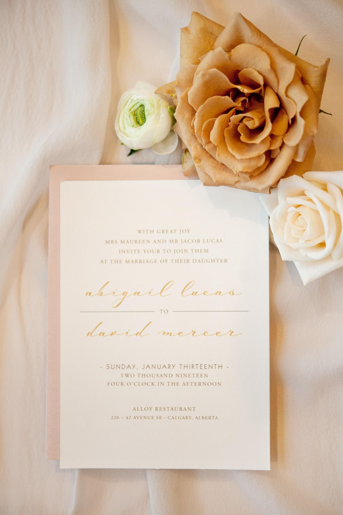 wedding invitation styled with roses captured by Tara Whittaker Photography