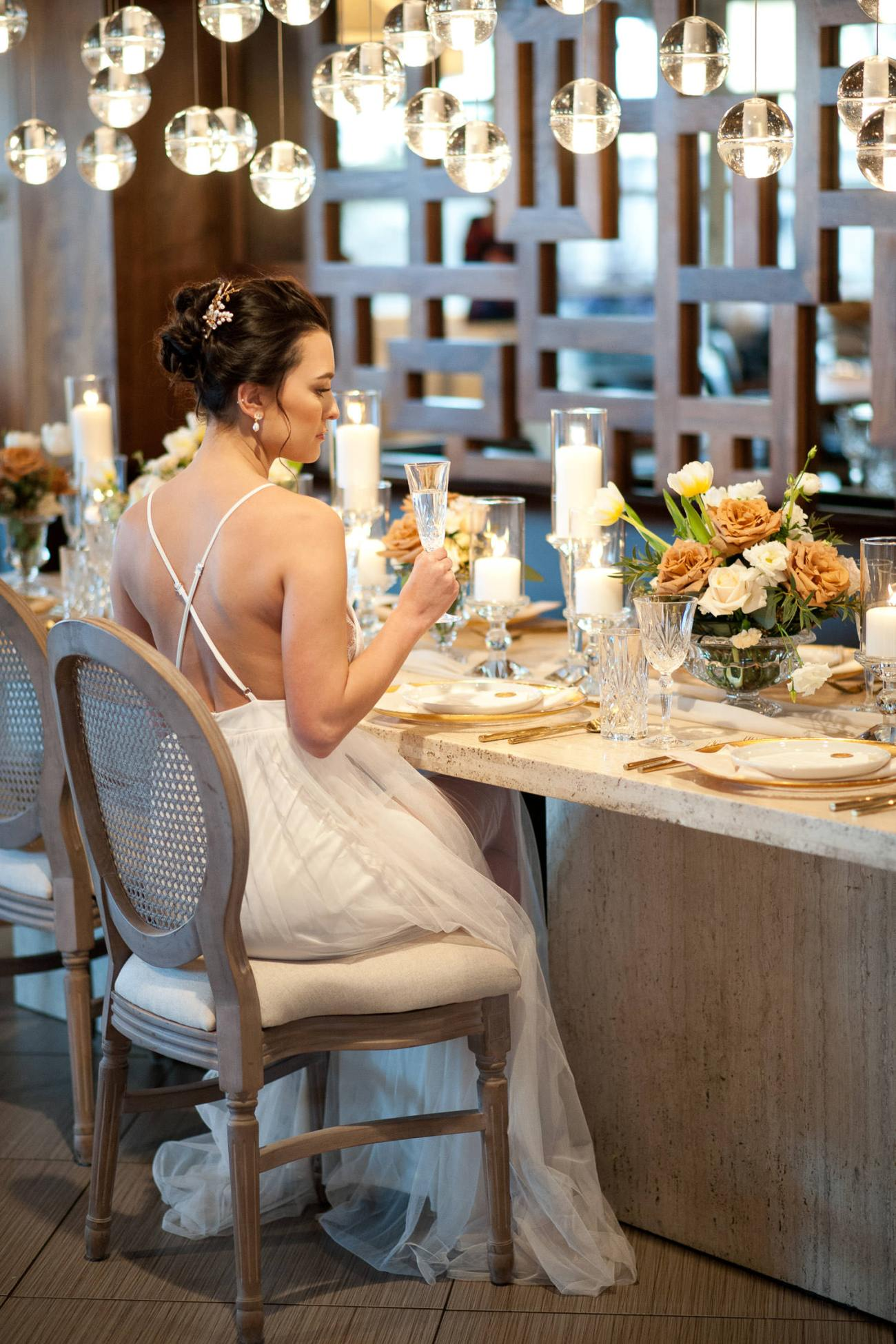 bride sits at the head table at Alloy restaurant captured by Tara Whittaker Photography