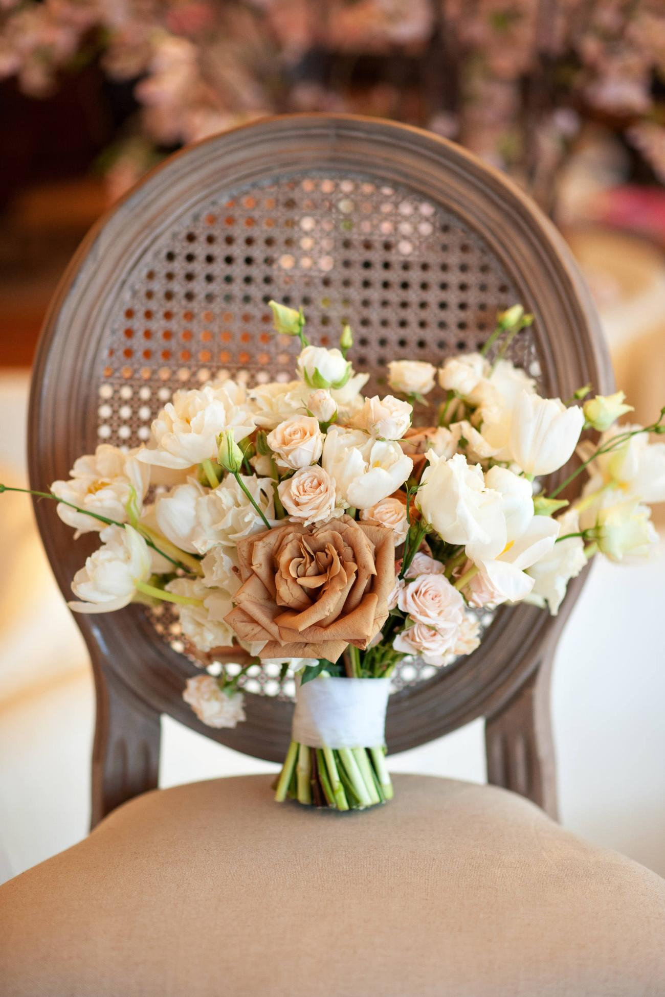 bride's bouquet in caramel, peach and white captured by Tara Whittaker Photography