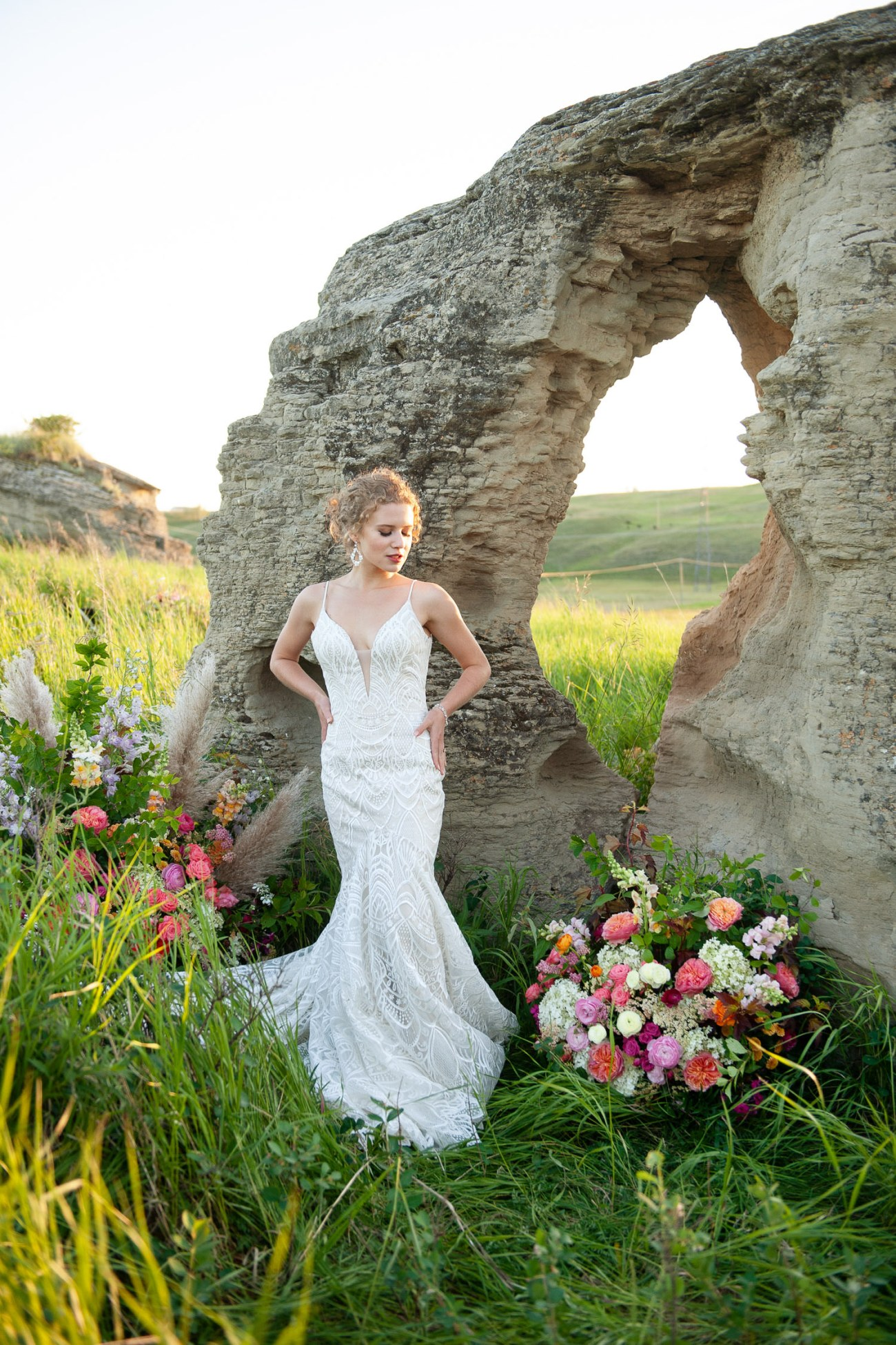 Bride stands at ceremony site captured by Tara Whittaker Photography