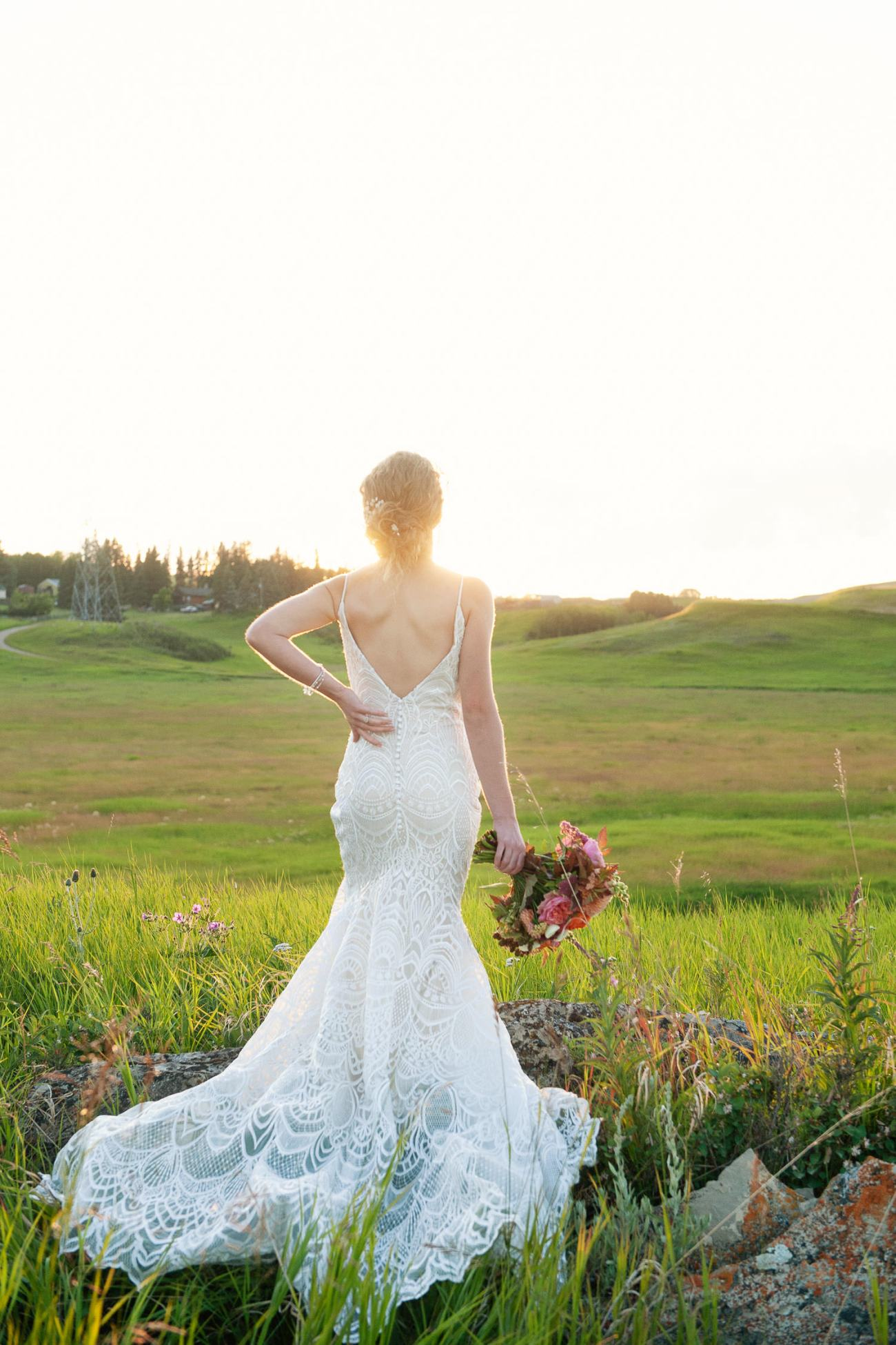 the back of a Lis Simon bridal gown captured by Tara Whittaker Photography