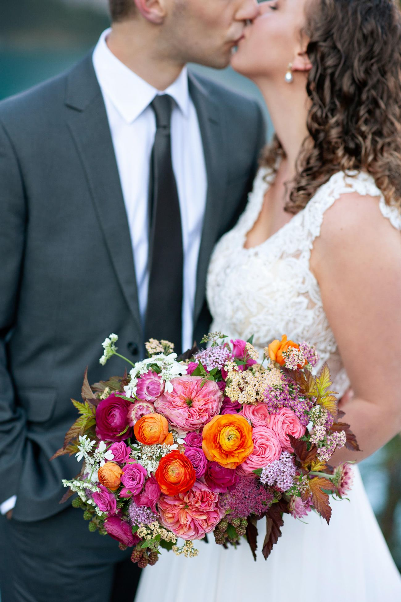 Moraine Lake bride carries a pink bouquet captured by Tara Whittaker Photography