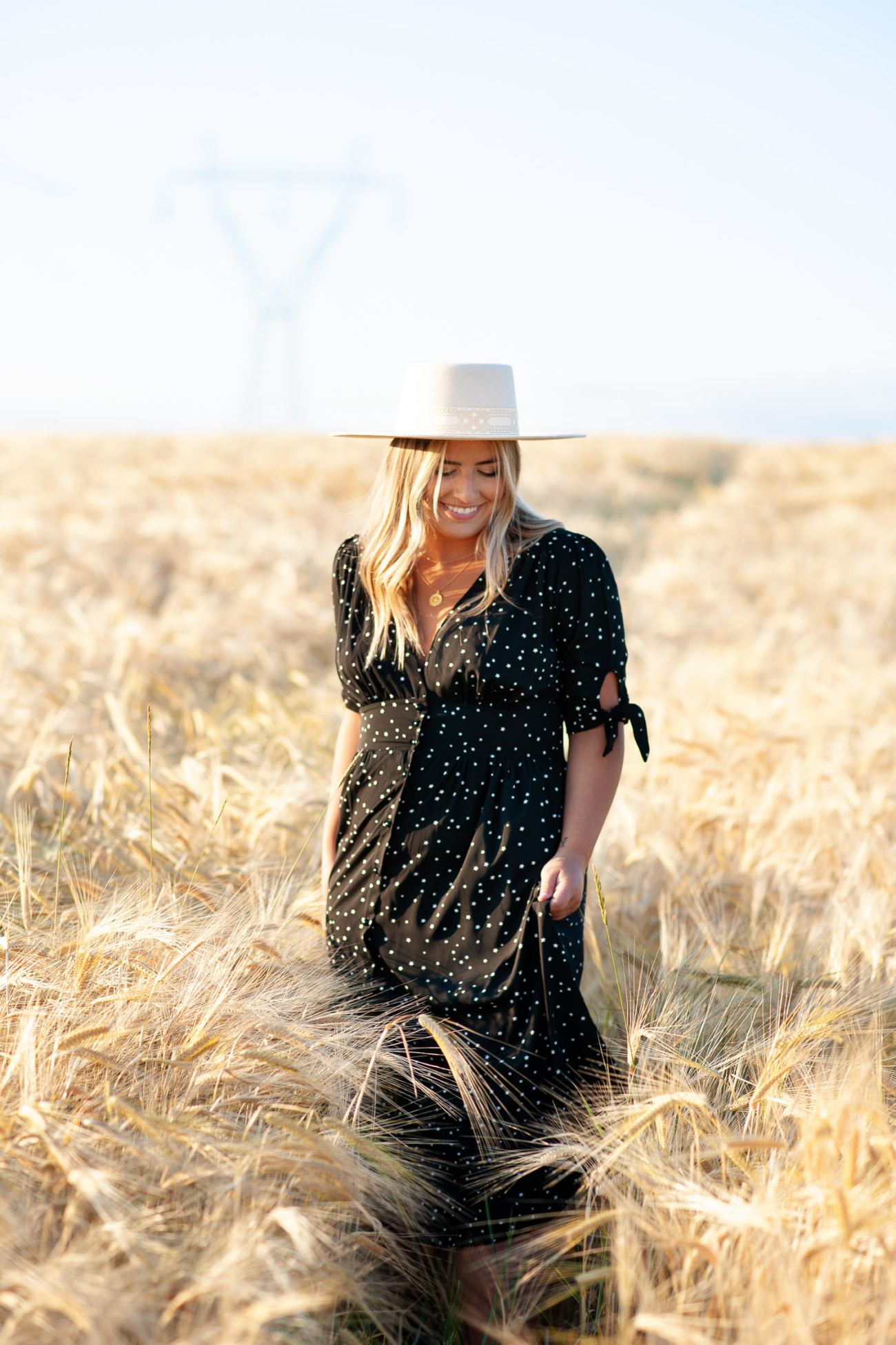 Wondering what to wear for your engagement session? This bride wore a pretty black dress captured by Tara Whittaker Photography