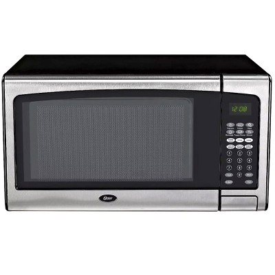 oster 1 3 cubic ft countertop microwave in silver and black