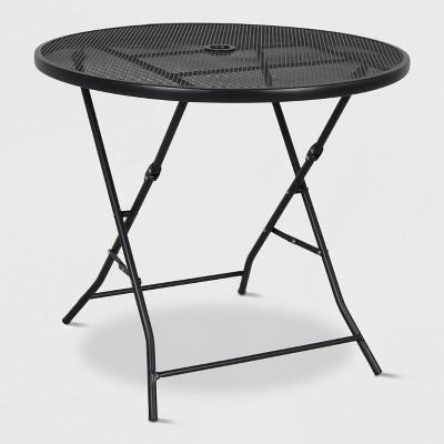 32 metal mesh folding patio table threshold