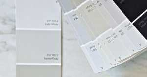 Paint samples on a marble countertop.