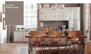 A kitchen with modern metal and wood chairs and a long slab dining table. The walls are a dark taupe color.