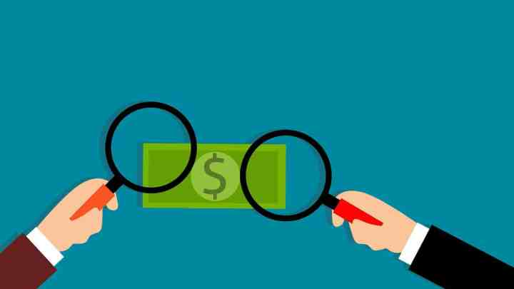 cartoon of fake counterfeit money being observed under a magnifying lense