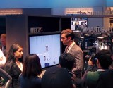 Samsung has a wearable suit with all this electronic stuff in it - your biz card is an NFC chip in the sleeve for example. Kinda dorky.