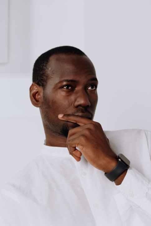 man in white dress shirt wearing black watch