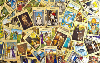 Types of Psychic Readings tarot cards spread out into a large pile