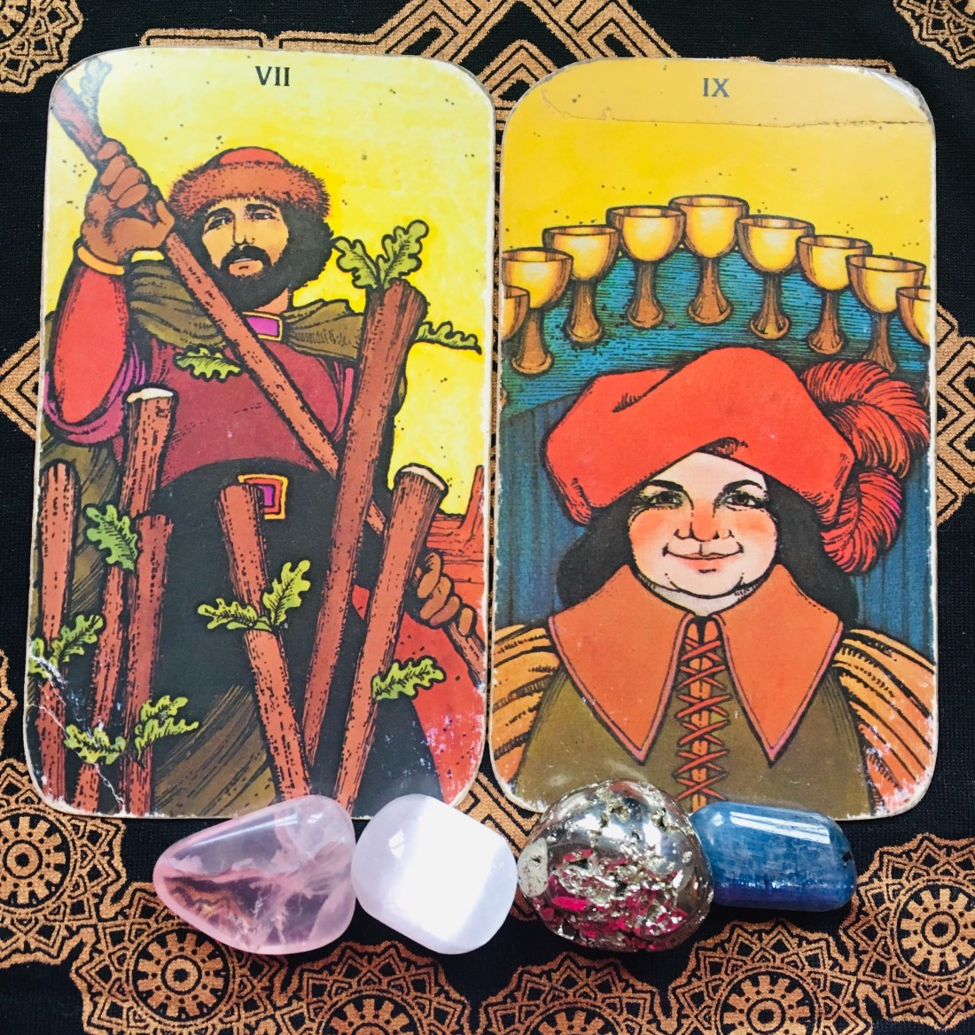 Nine of Cups and Seven of Rods, Tarot cards.