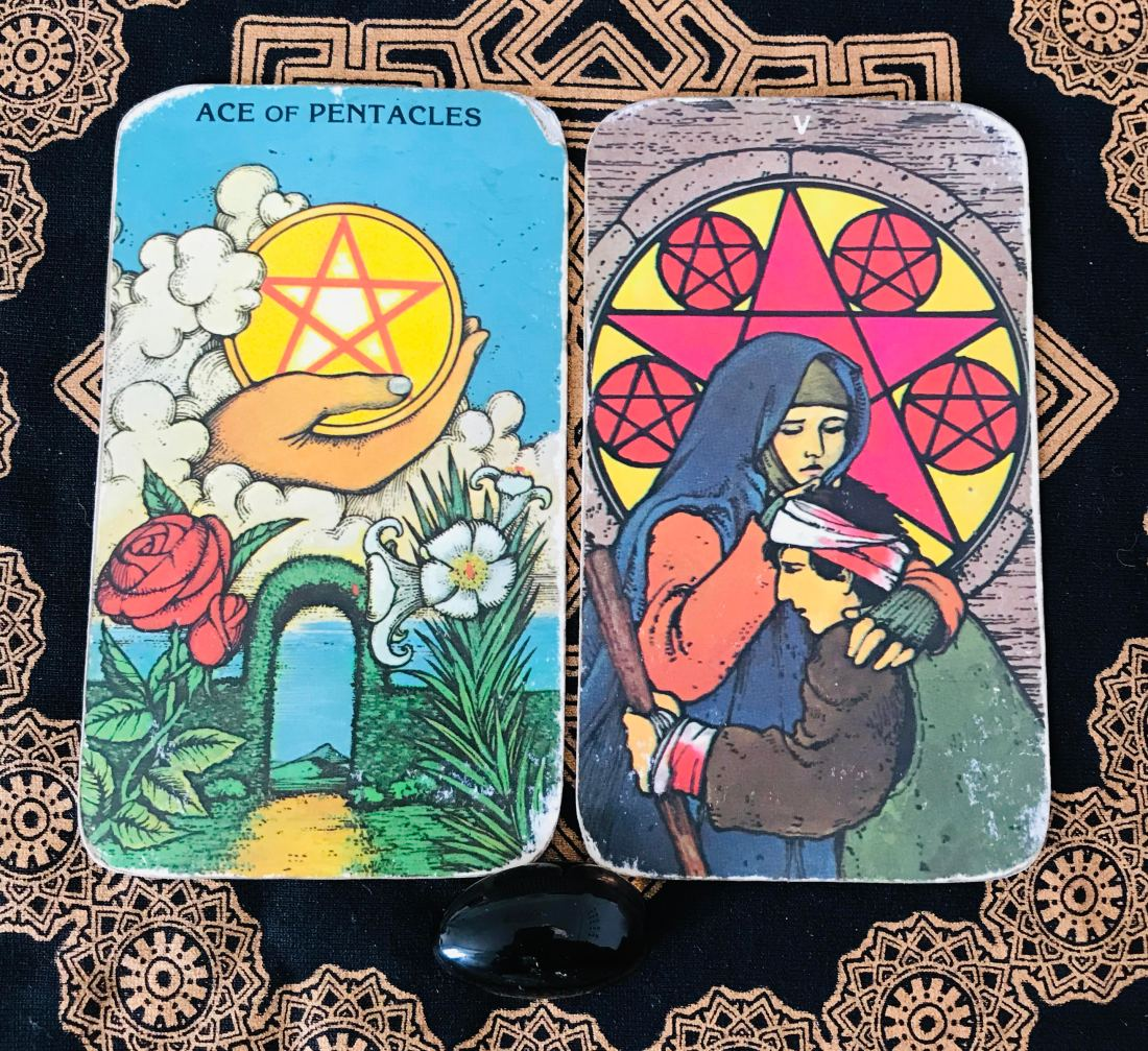 Tarot cards Ace of Coins and Five fo Coins, for rest