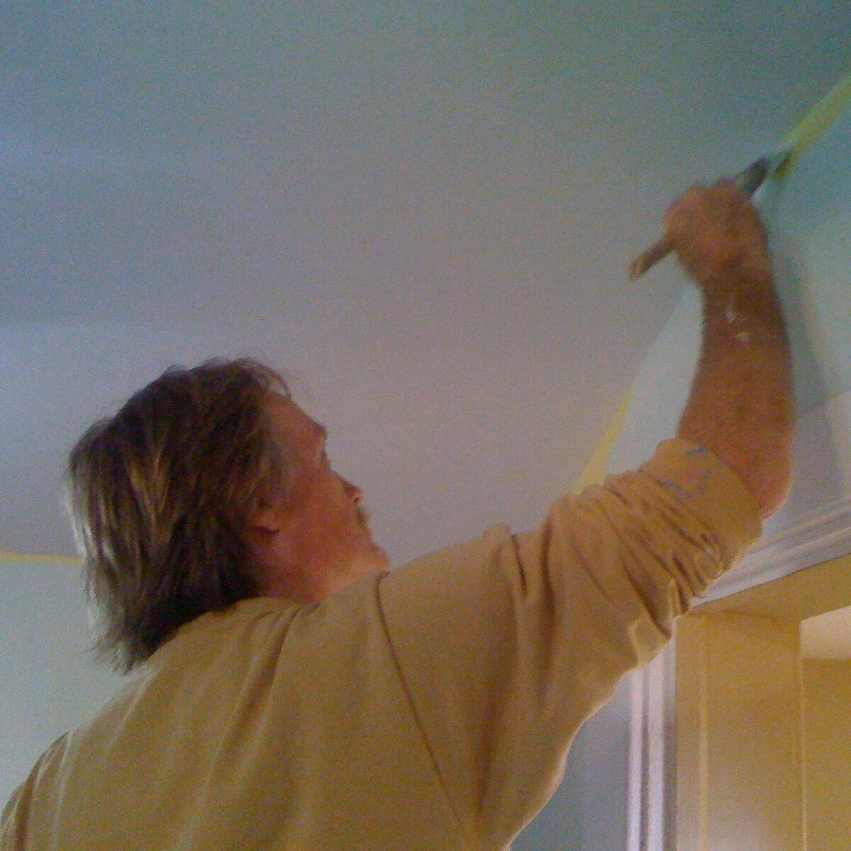 Volunteer Michael Aitchison applying a fresh coat of paint in 2010.