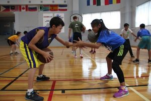 Children practice at basketball camp in Central Asia. Courtesy of Sophie Linnell