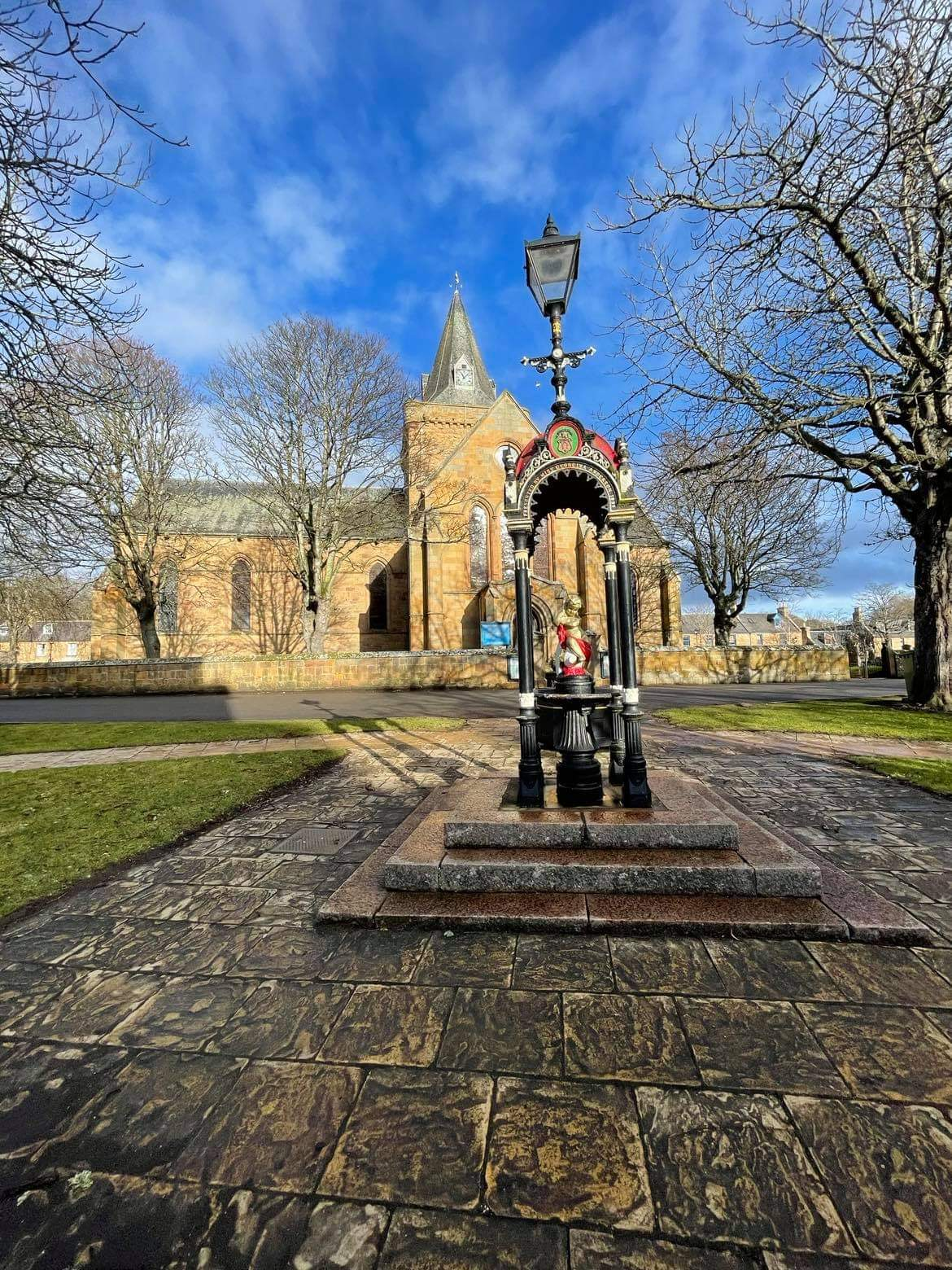 Ornate lampost and Dornoch Cathedral