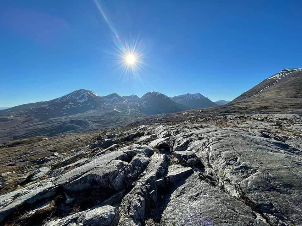 blazing sun over Rocky mountain trail Beinn Eighe