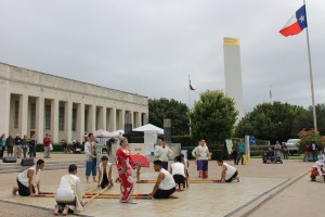 A group of Filipino dancers in front of the Dallas Historical Society building. The dance was about a princess lost in the forest during an earthquake. The prince comes to rescue her.