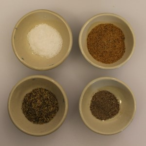 From top left: salt, Old Bay, pepper, thyme