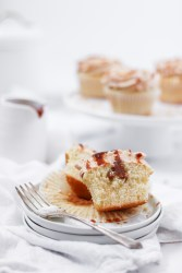 A Peanut Butter Dulce de Leche Cupcakes cut in half to see the filling.