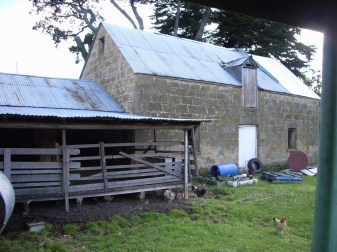 Our farmyard with the sheep gratings and the stables