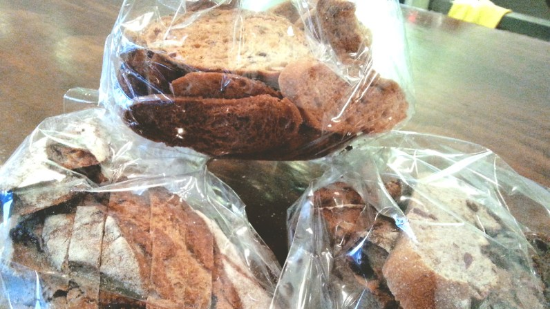 A Bag of Rusk and two Cranberry and Walnut Rye Breads at Jam & Bread